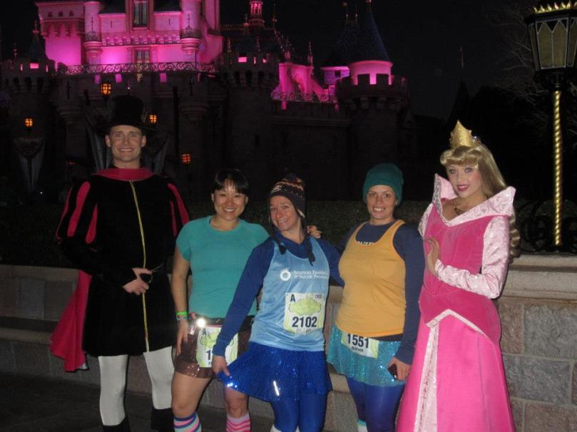 Aurora and her Prince in front of Sleeping Beauty Castle.