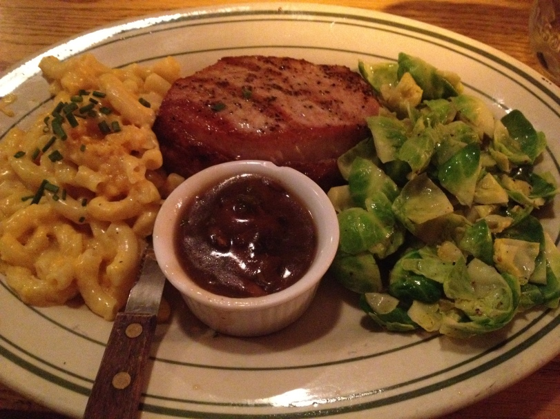 Grilled pork chop, mac and cheese, brussel sprouts.