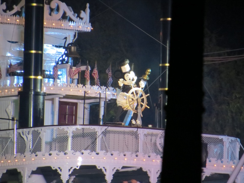 Steamboat Willie leading the character boat out during Fantasmic!